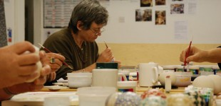Marion decorating a bowl at Edinburgh Ceramic Studio. Photography: Artists Own